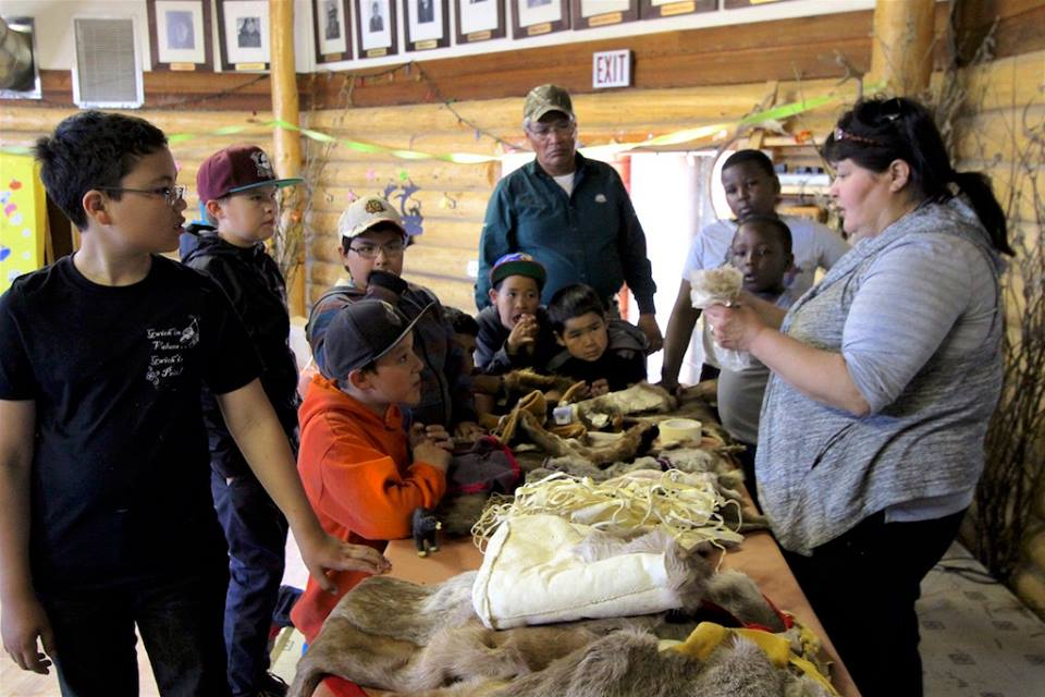 Caribou Days coordinator Teresa Frost showing youth traditional materials made from caribou